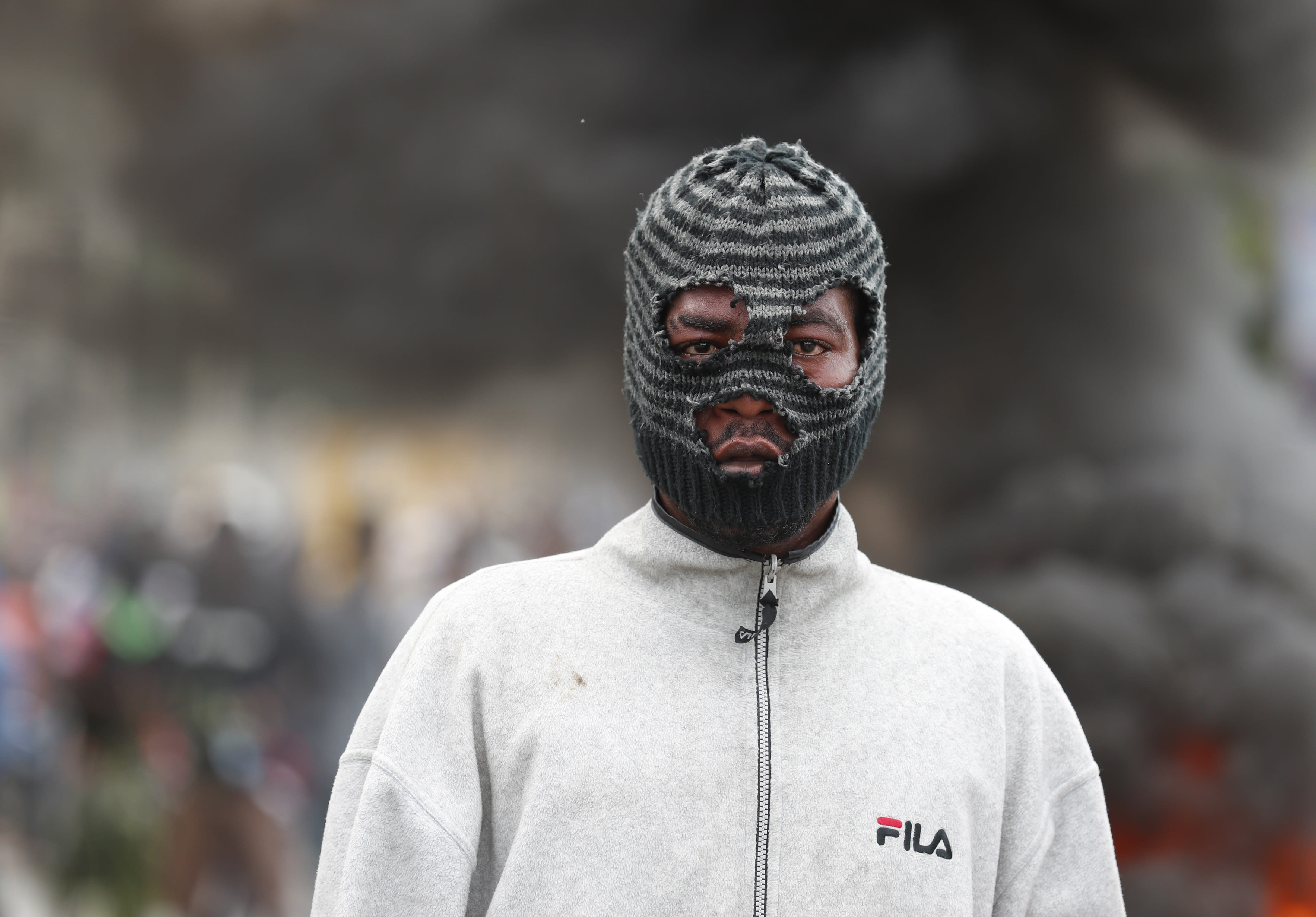 A masked demonstrator joins a protest calling for the resignation of President Jovenel Moise, in Port-au-Prince, Haiti, Friday, Oct. 4, 2019. After a two-day respite from the recent protests that have wracked Haiti's capital, opposition leaders urged citizens angry over corruption, gas shortages, and inflation to join them for a massive protest march to the local headquarters of the United Nations.(AP Photo/Rebecca Blackwell)