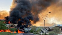 A bridge over an Arizona lake was engulfed in flames and partially collapsed after a train derailment