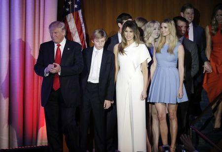 U.S. President-elect Donald Trump, his wife Melania, daughter Ivanka, son Barron and other family members greet supporters during his election night rally in Manhattan, New York, U.S., November 9, 2016. REUTERS/Mike Segar