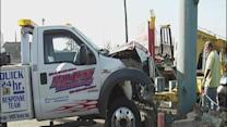Tow truck crashed into parking lot