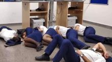 Ryanair crew photographed sleeping on airport floor in Malaga - but photo was staged, says airline