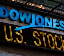 Dow crosses 28,000 with big boost from one company