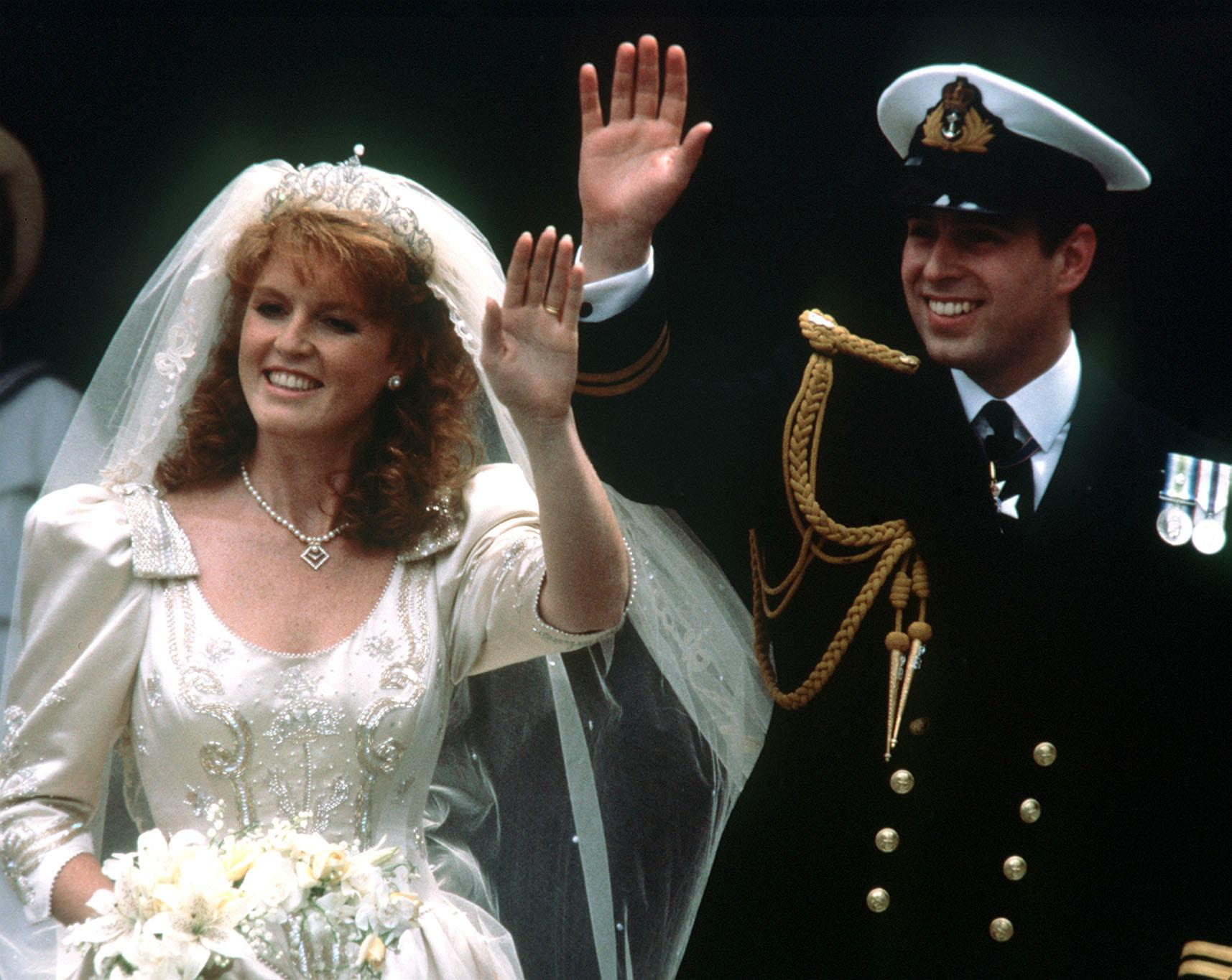 """File photo dated 23/07/1986 of Prince Andrew and his bride Sarah Ferguson waving to crowds as they leave Westminster Abbey, London after their wedding ceremony. When Princess Eugenie's parents married, Britain was in the grip of """"Fergie Fever""""."""