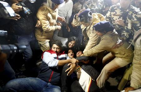 Police detain demonstrators during a protest against the release of a juvenile rape convict, in New Delhi, India, December 20, 2015. REUTERS/Adnan Abidi