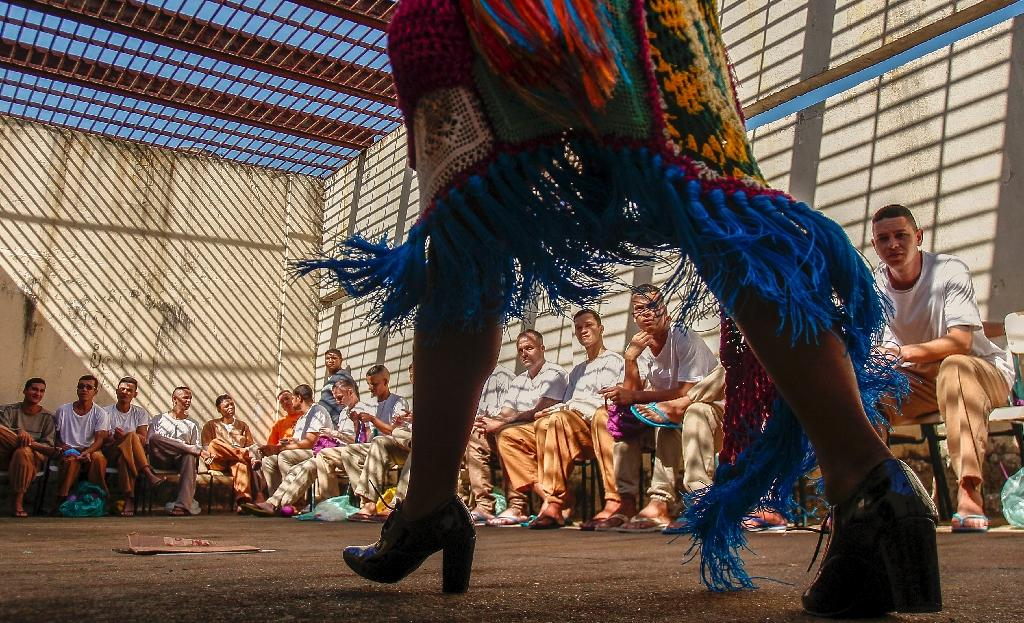 Intricate crochet bodices, cheeky skirts and denim finishes featured in a fashion show at the Adriano Marrey prison outside Sao Paulo (AFP Photo/Miguel SCHINCARIOL)