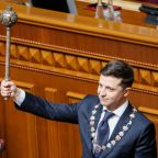 High fives, selfies and a snap election as Zelenskiy takes power in Ukraine