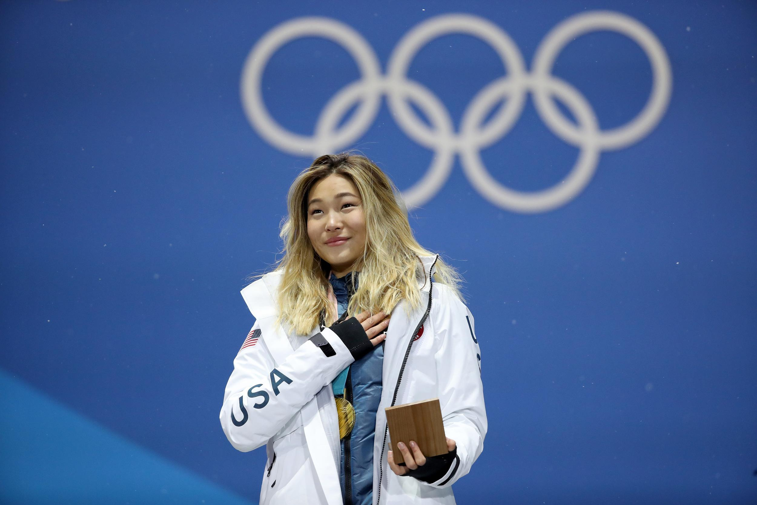 PYEONGCHANG-GUN, SOUTH KOREA - FEBRUARY 13:  Gold medalist Chloe Kim of the United States poses during the medal ceremony for the Snowboard Ladies' Halfpipe Final on day four of the PyeongChang 2018 Winter Olympic Games at Medal Plaza on February 13, 2018 in Pyeongchang-gun, South Korea.  (Photo by Sean M. Haffey/Getty Images)