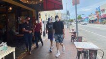 Miami vuelve a cerrar los restaurantes cuando muertes por coronavirus en EEUU superan las 130.000