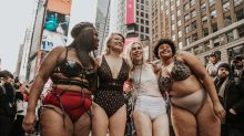People model lingerie in Times Square to challenge body stereotypes perpetuated by Victoria's Secret