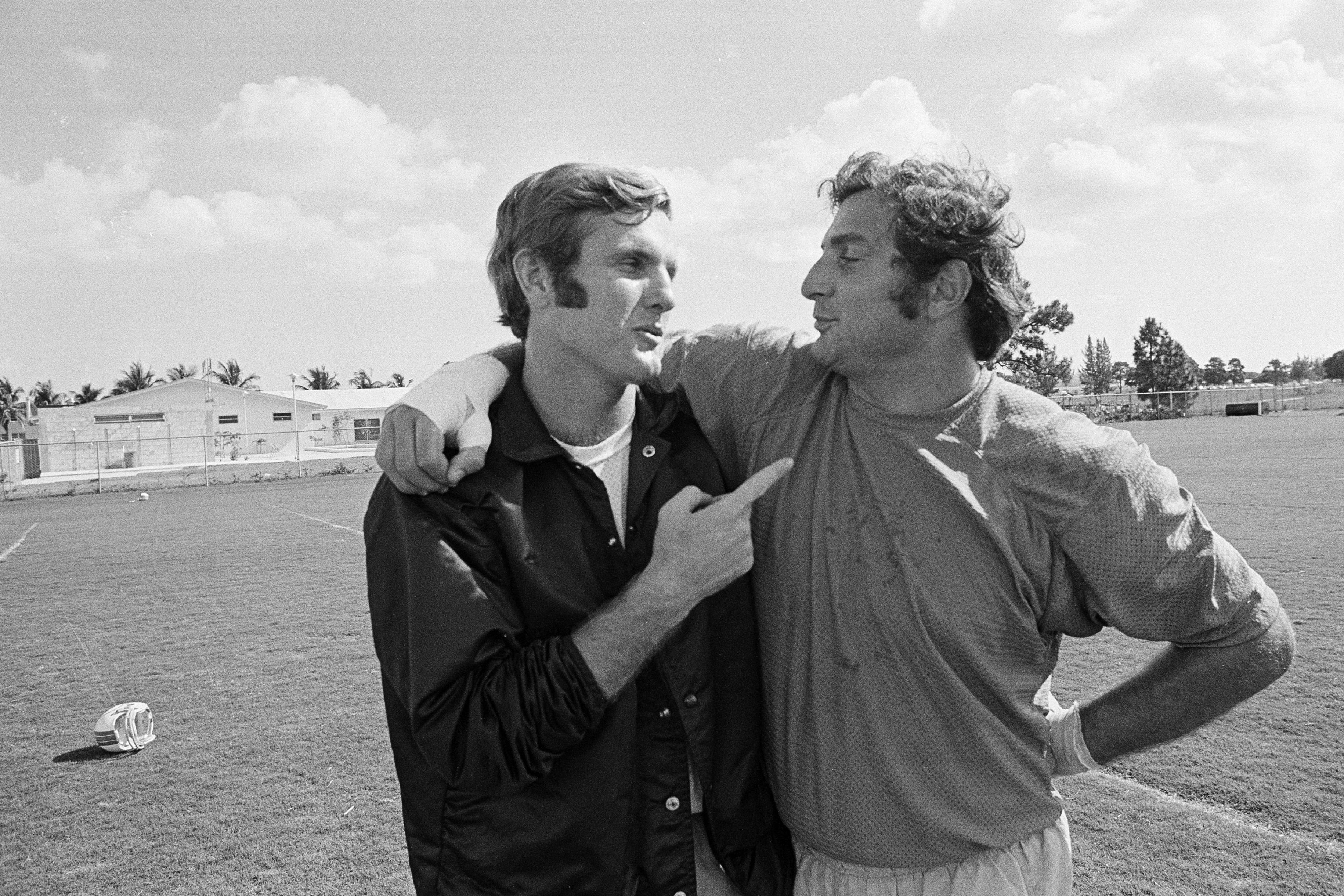 FILE - In this Jan. 5, 1972, file photo, Miami quarterback Bob Griese, left, and linebacker Nick Buoniconti talk about the upcoming Super Bowl against Dallas, in Miami. Pro Football Hall of Fame middle linebacker Nick Buoniconti, an undersized overachiever who helped lead the Miami Dolphins to the NFL's only perfect season, has died at the age of 78. Bruce Bobbins, a spokesman for the Buoniconti family, said he died Tuesday, July 30, 2019, in Bridgehampton, N.Y. (AP Photo/File)