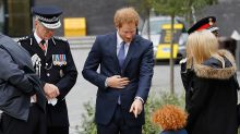 Prince Harry and his adorable red-headed lookalike are perfectly paired in matching blue suits