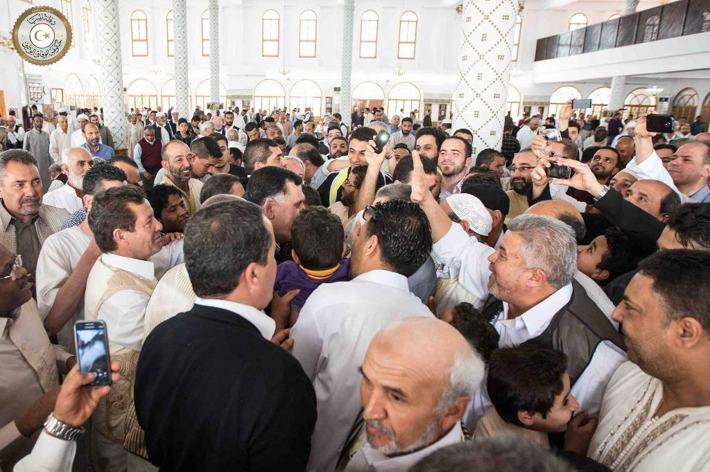 The official Facebook media page of Fayez al-Sarraj, prime minister of the UN-backed unity government, show him being greeted by people at a mosque in Tripoli, on April 1, 2016 (AFP Photo/)