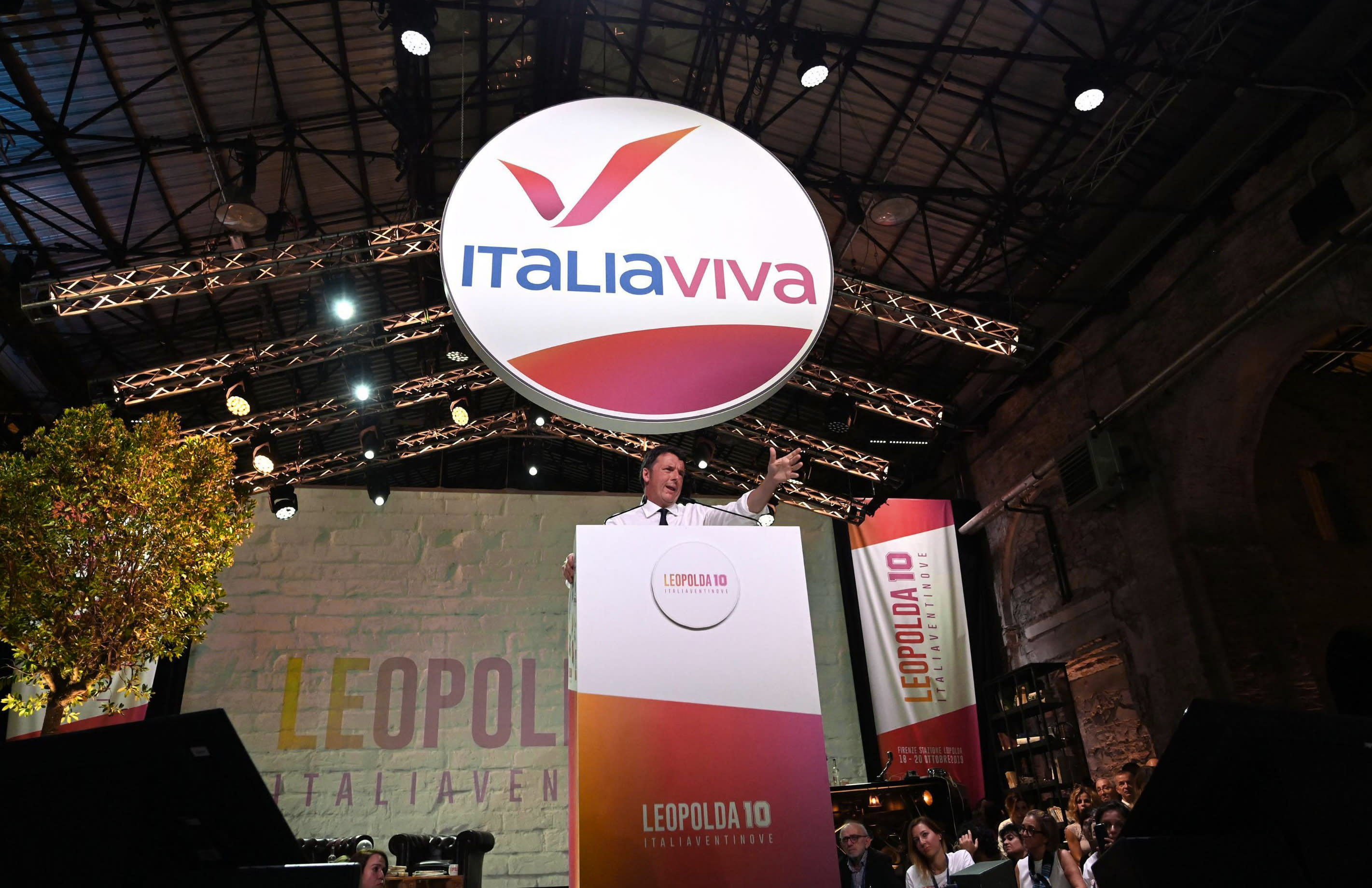 Former Italian Premier and founder of the Italia Viva (Italy alive) party Matteo Renzi speaks at a meeting in Florence, Italy, Sunday, Oct. 20, 2019. (Claudio Giovannini/ANSA via AP)