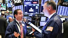 Stocks slip slightly amid trade remarks, earnings season