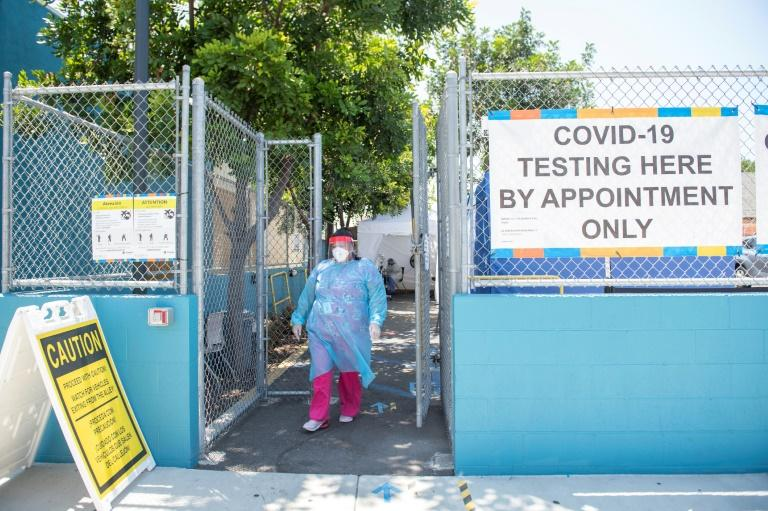 For the second straight day, the US reported over 70,000 new cases of coronavirus and over 1,000 deaths (AFP Photo/VALERIE MACON)