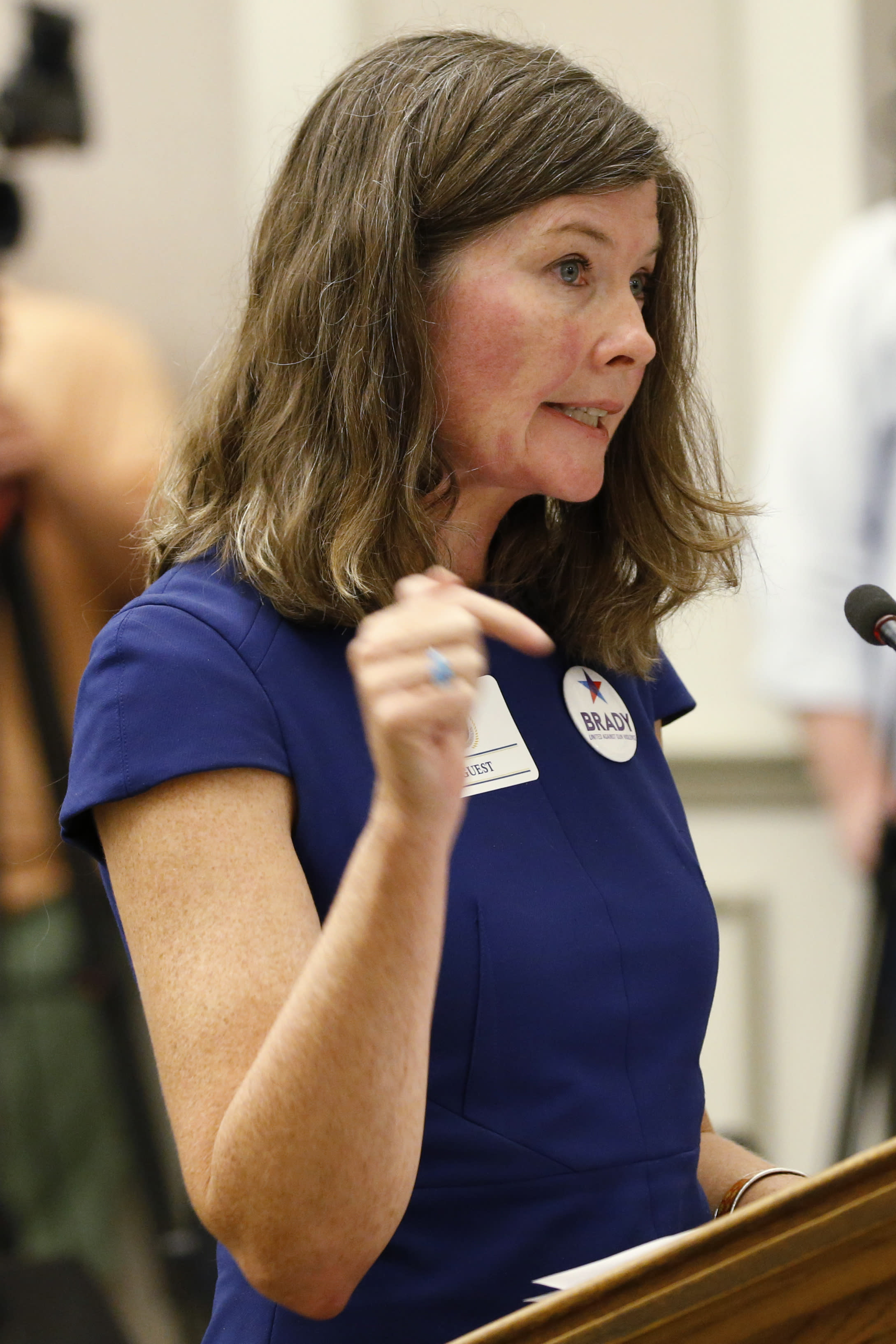 Kris Brown, president of gun control advocacy group Brady, testifies during the second day of a Virginia Crime Commission meeting on gun issues at the Capitol in Richmond, Va., Tuesday, Aug. 20, 2019. (AP Photo/Steve Helber)