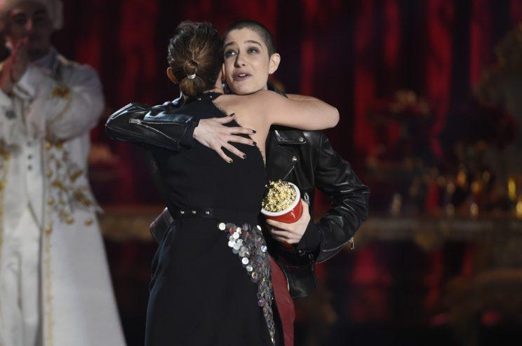Emma Watson hugging Asia Kate Dillon while accepting the Best Actor in a Movie award. (Photo: AP Images)