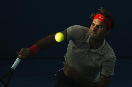 Federer of Switzerland serves to Chardy of France during men's singles semi-final match at Brisbane International tennis tournament in Brisbane