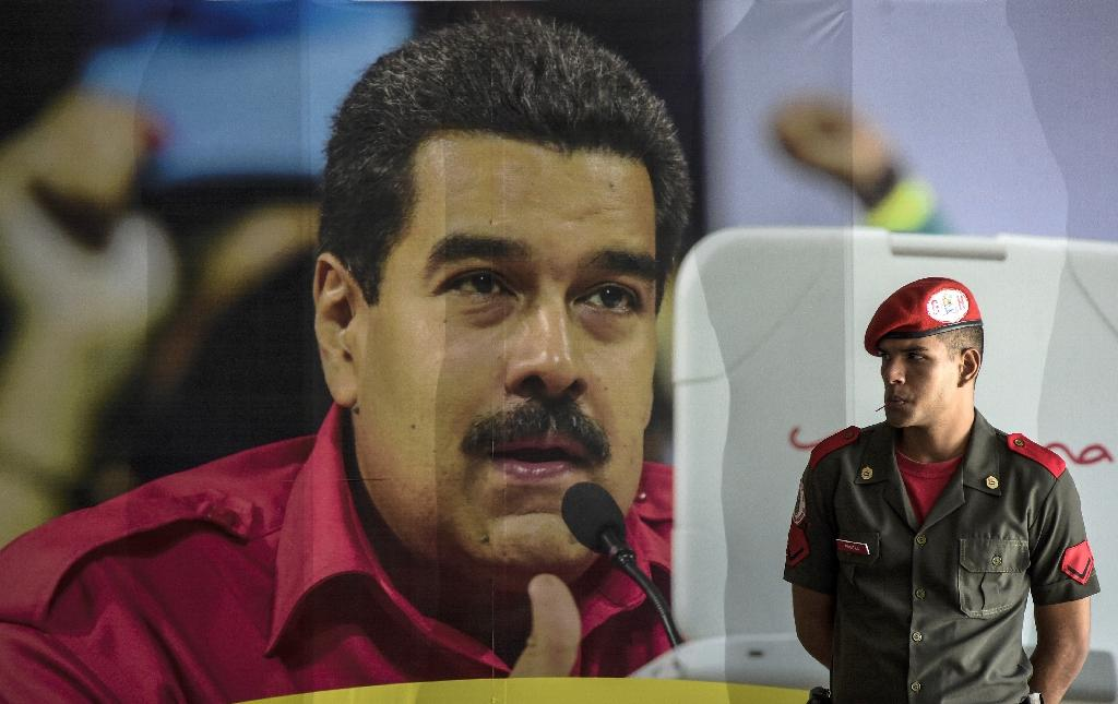 The opposition blame Venezuelan President Nicolas Maduro for an economic meltdown with people spending long hours lining up only to find bare shelves and soaring prices (AFP Photo/Juan Barreto)
