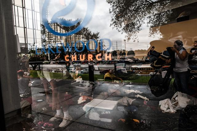 Volunteers take donations at the Lakewood Church in Houston.  (Joseph Rushmore for HuffPost)