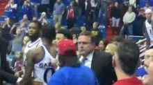 Fan Captures Close-Up of Brawl Between Warring College Basketball Teams