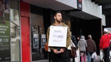 Man wears 'Rape. It's Her Fault' sign. People's reactions will shock you.