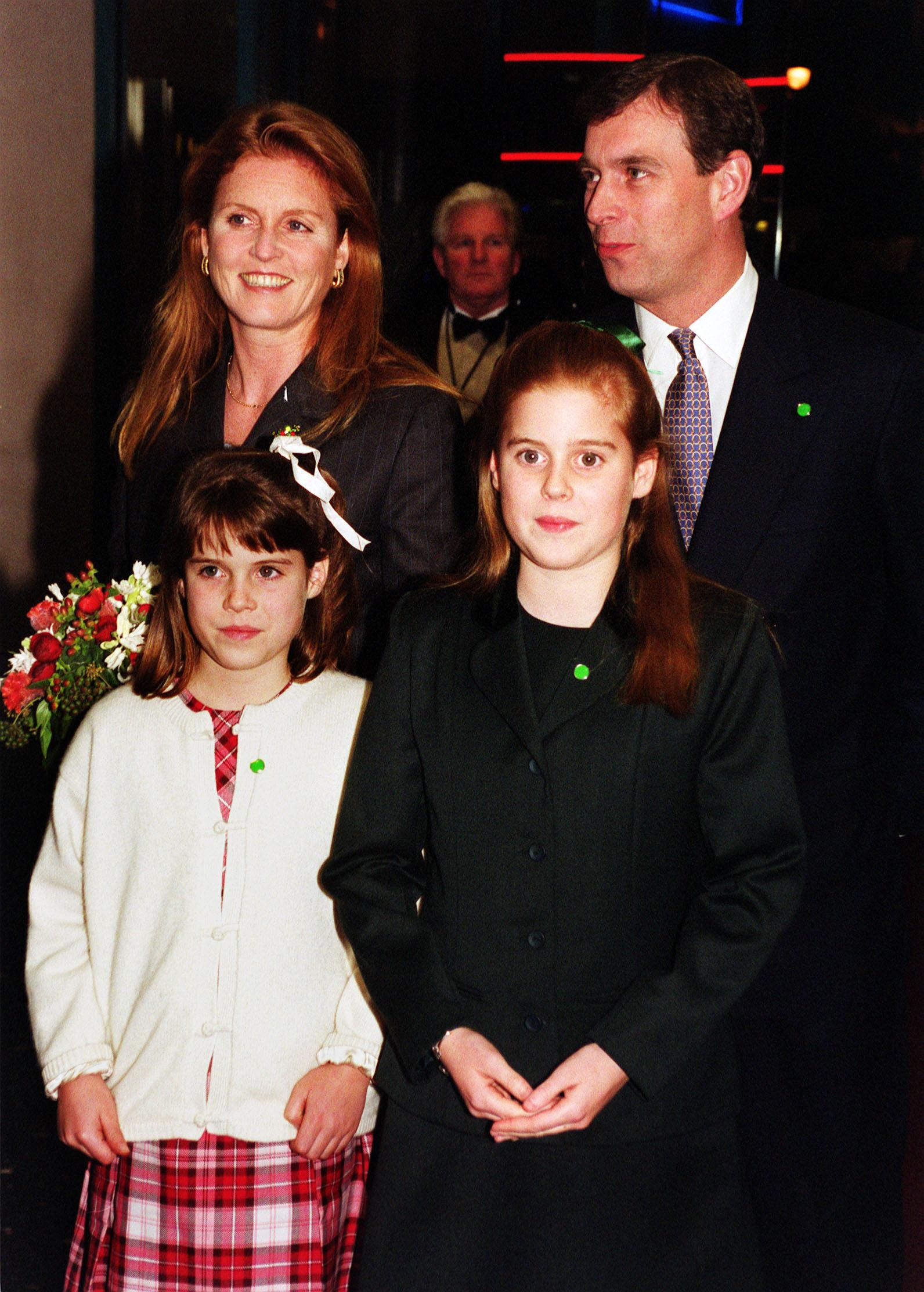 The Duke and Duchess of York arrive with their daughters, Princess Beatrice and Princess Eugenie (left), at the Warner Village, Leicester Square, for the Royal charity premiere of The Iron Giant.  * An animated film, based on the short story by the late Poet Laureate Ted Hughes, which tells the story of a massive robot who falls to earth and is befriended by a lonely nine-year-old boy.