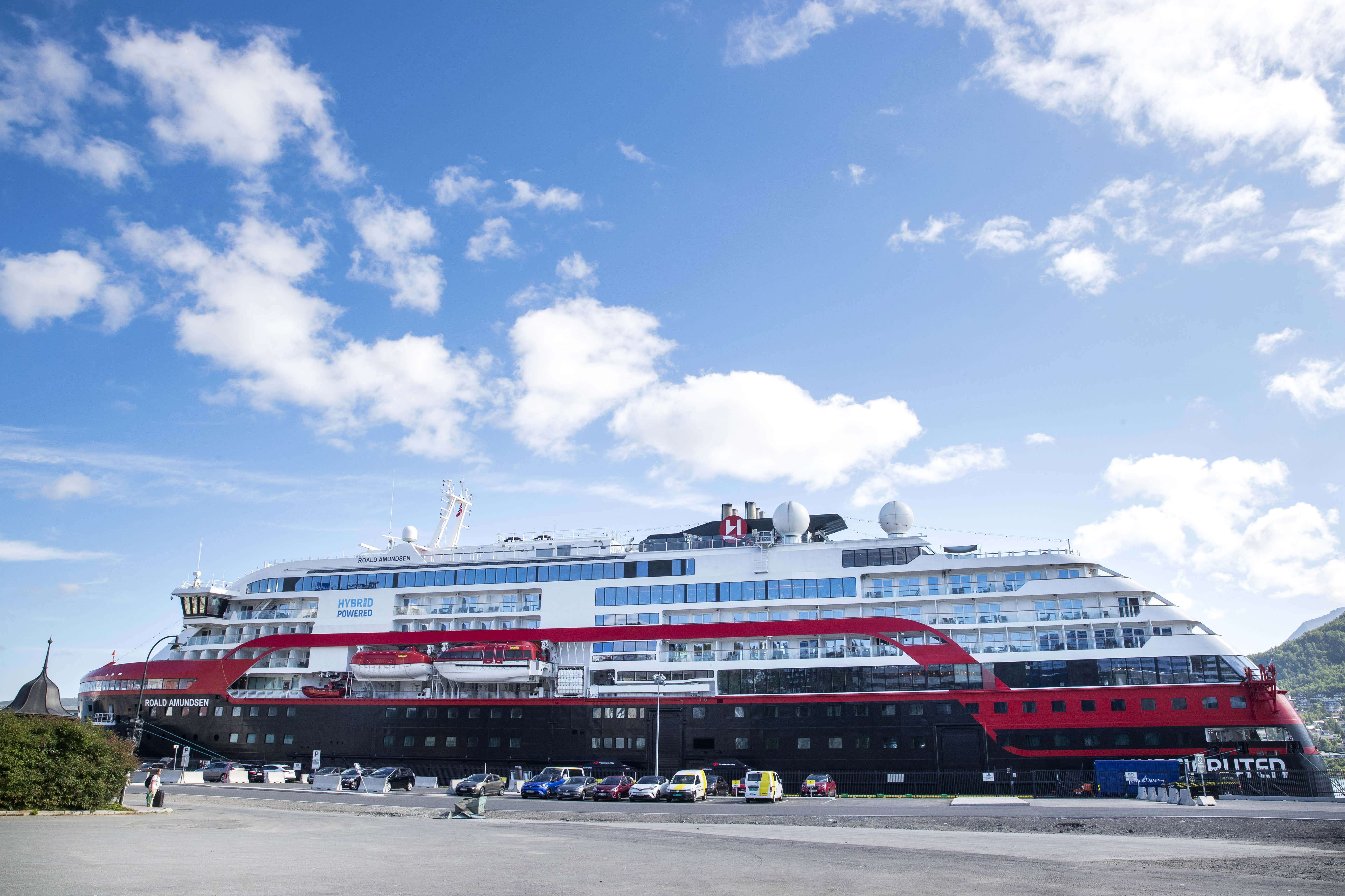 A view of the Hurtigruten's vessel MS Roald Amundsen, docked in Tromso, Norway, Sunday, Aug. 2, 2020. Over 30 crew members and an unconfirmed number of passengers have so far tested positive for the coronavirus after two international cruises which resumed operation recently, since the outbreak of the coronavirus pandemic. (Terje Pedersen/NTB scanpix via AP)