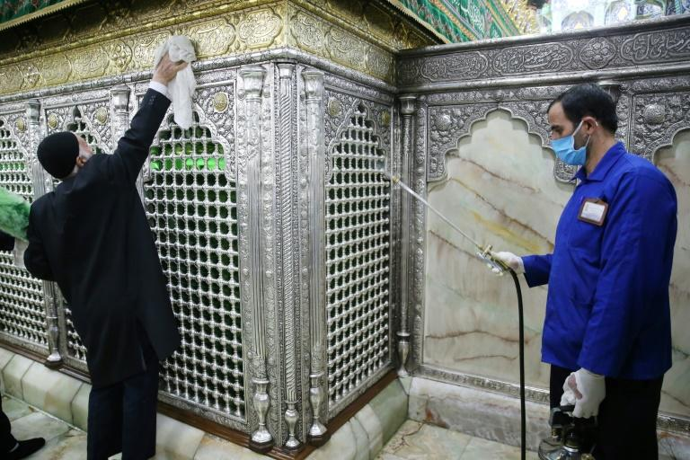 Iranian sanitary workers disinfect the revered Masumeh shrine in the Shiite holy city of Qom, which has been the epicentre of the COVID-19 outbreak in the Islamic republic (AFP Photo/MEHDI MARIZAD)