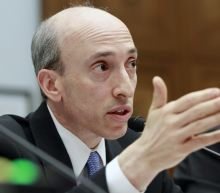Senate OKs tough former regulator as market watchdog chief