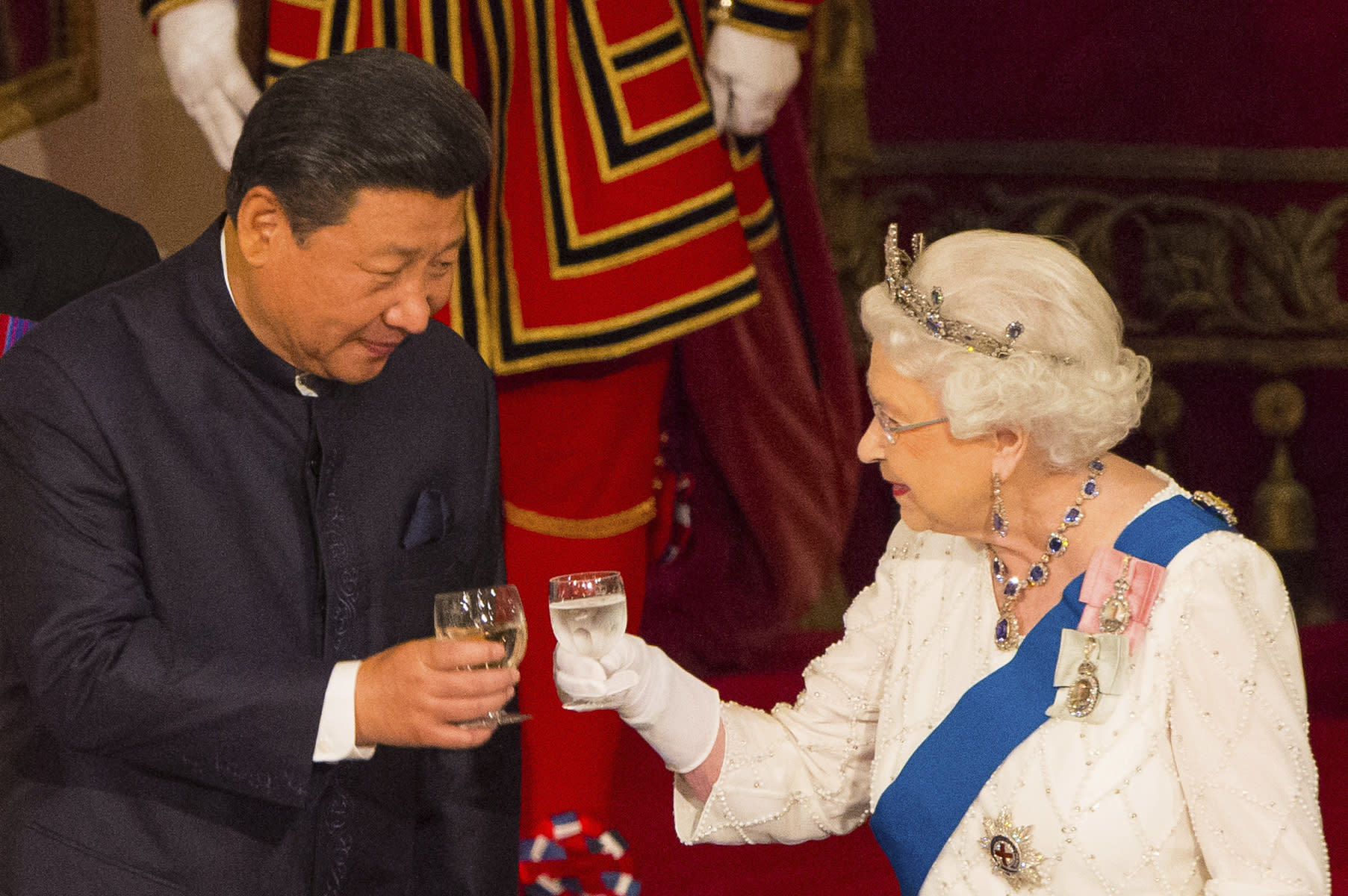 "FILE - In this Tuesday Oct. 20, 2015 file photo, Chinese President Xi Jinping with Britain's Queen Elizabeth II during a state banquet at Buckingham Palace, London, on the first day of the state visit to Britain. Only five years ago, former British Prime Minister David Cameron was celebrating a ""golden era"" in U.K.-China relations, bonding with President Xi Jinping over a pint of beer at the pub and signing off trade deals worth billions. Those friendly scenes now seem like a distant memory, with hostile rhetoric ratcheting up this week over Beijing's new national security law on Hong Kong. China has threatened ""consequences"" after Britain offered refuge to millions in the former colony. (Dominic Lipinski/Pool Photo via AP, File)"