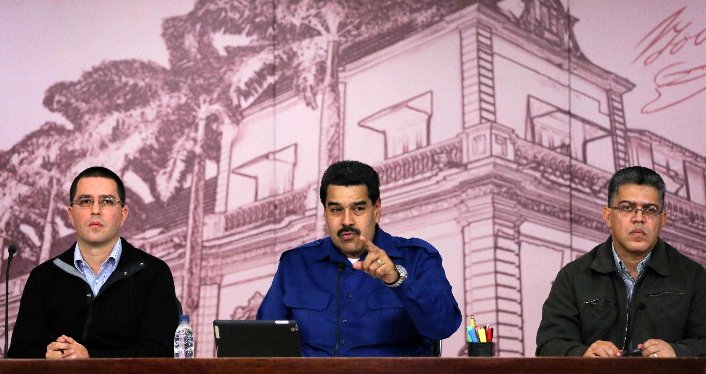 """Flanked by Venezuela's Vice President Jorge Arreaza, left, and Foreign Minister Elia Jaua, President Nicolas Maduro speaks at a news conference at Miraflores presidential palace in Caracas, Venezuela, Monday, Dec. 30, 2013. Maduro said Monday that annual inflation hit 56.2 percent. Earlier the Central Bank said inflation slowed in the last two months of the year after Maduro took action to slash prices of appliances. The Central Bank justified a nearly three-week delay in issuing its report because of """"exceptional and historic"""" measures taken by Maduro to fight price speculators trying to destabilize the country. (AP Photo/Fernando Llano)"""
