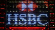 HSBC profits plunge as bank navigates political storms