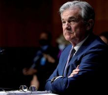Dow Jones Falls As Fed Sees Rates Rising Sooner; Apple Dips; AMC Stock Plunges, Meme Names Fall