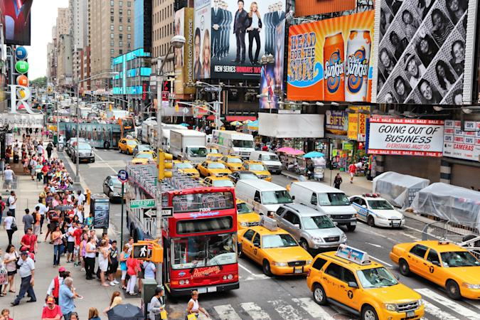 People visit 7th Avenue near Times Square in New York. The square at junction of Broadway and 7th Avenue has some 39 million visitors anually.