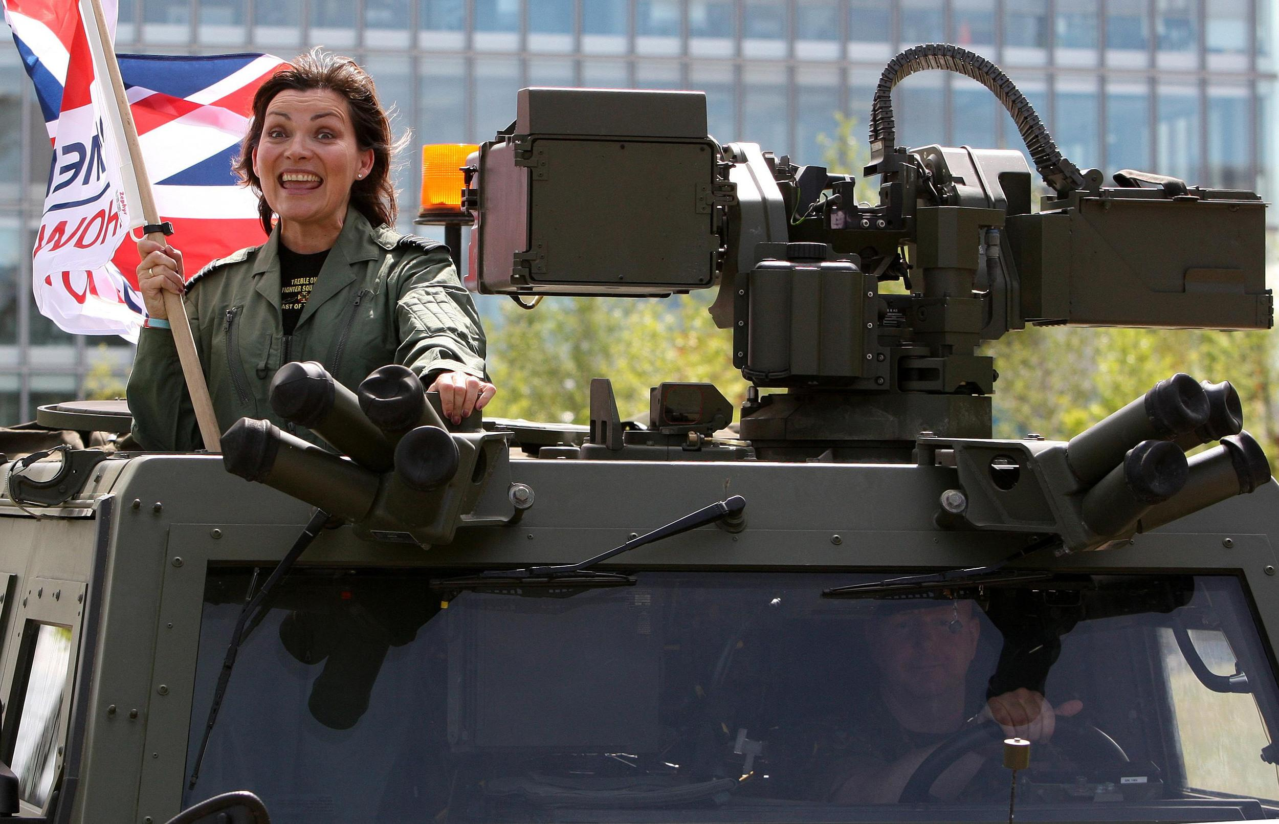 TV presenter Lorraine Kelly rides in a tank as she helps to promote Armed Forces Day, she set off from RAF Leuchars in Fife, flying by Royal Navy helicopter to Scotstoun shipyard in Glasgow.
