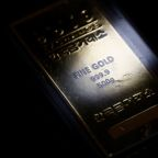 Gold slides as stocks rally, but still set for weekly gain