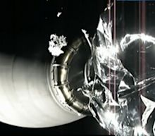 Watch this Piece of Ice Gently Drift Past the SpaceX Camera