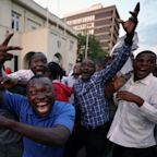 Zimbabweans Celebrate In The Streets After Mugabe Resignation