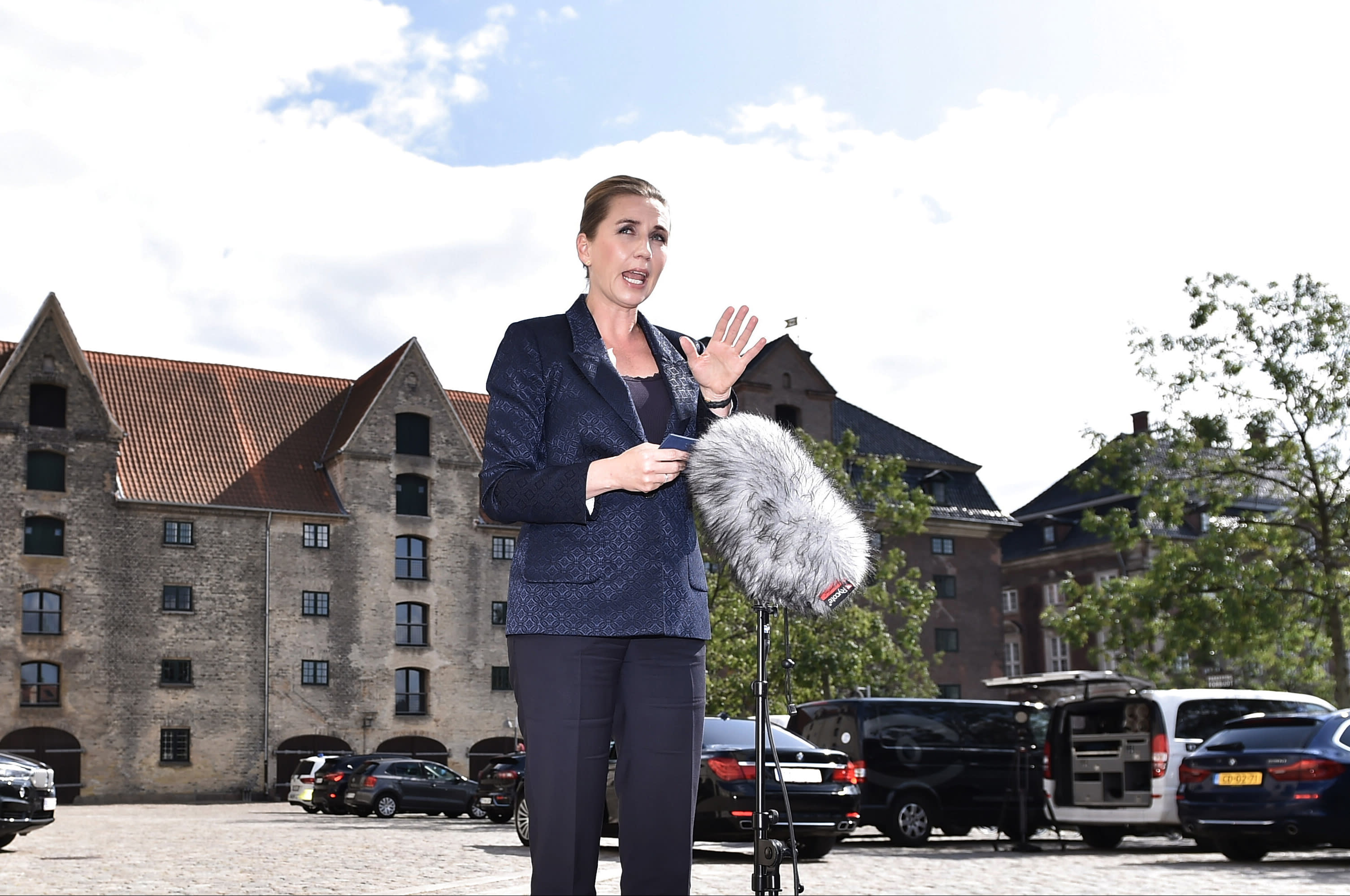 """Denmark's Prime Minister Mette Frederiksen makes a comment on US President's cancellation of his scheduled State Visit, in front of the State Department in Copenhagen, Wednesday, Aug. 21, 2019. U.S. President Trump announced his decision to postpone a visit to Denmark by tweet on Tuesday Aug. 20, 2019, after Danish Prime Minister Mette Frederiksen dismissed the notion of selling Greenland to the U.S. as """"an absurd discussion."""" (Mads Claus Rasmussen / Ritzau Scanpix)"""