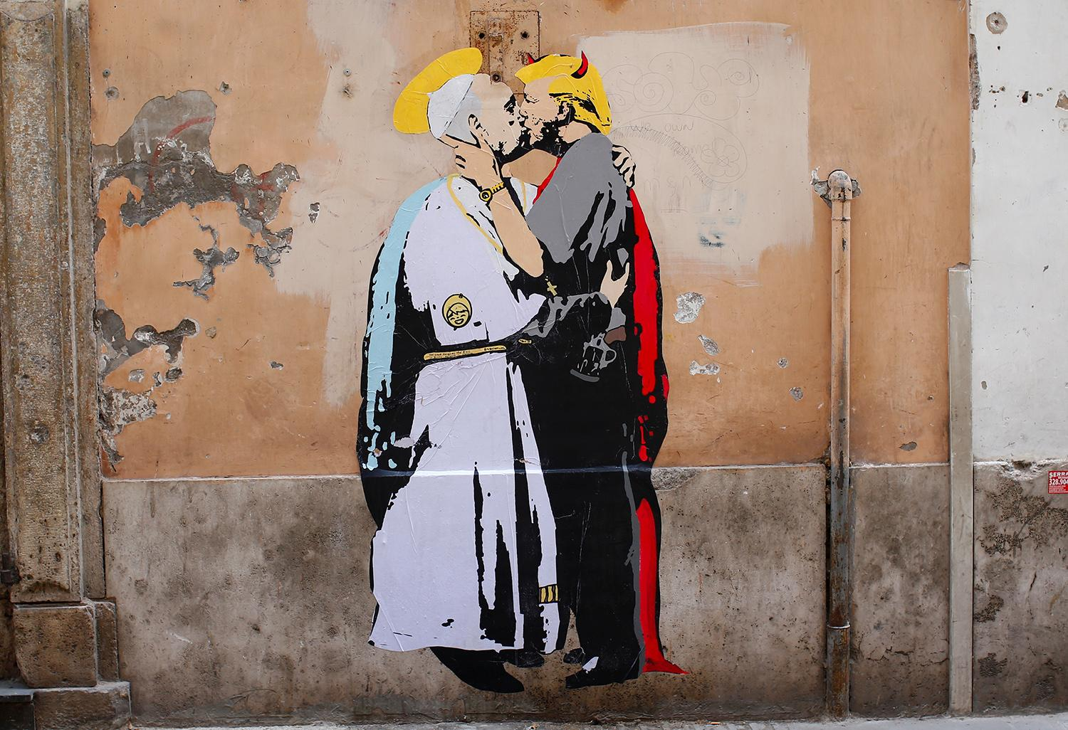 """<p>A mural signed by """"TV Boy"""" and depicting Pope Francis and U.S. President Donald Trump kissing, is seen on a wall in downtown Rome, Italy May 11, 2017. (Photo: Tony Gentile/Reuters) </p>"""