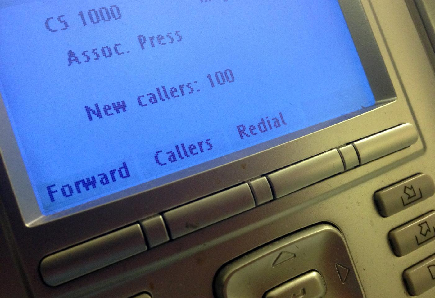 """The screen on the phone console at the reception desk at The Associated Press Washington bureau, Monday, May 13, 2013. The Justice Department secretly obtained two months of telephone records of reporters and editors for The Associated Press in what the news cooperative's top executive called a """"massive and unprecedented intrusion"""" into how news organizations gather the news. (AP Photo/Jon Elswick)"""