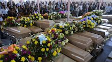 Mass funeral held for 20 Haitians who died in dismal prison