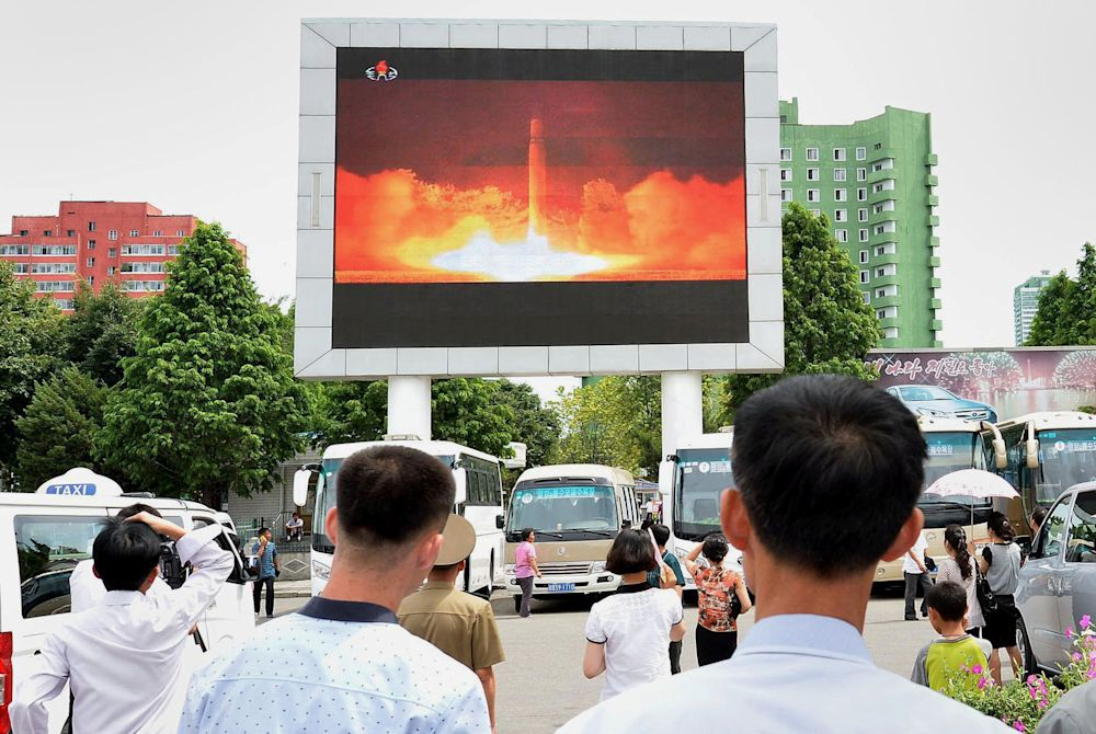 People watch news report showing North Korea's Hwasong-14 missile launch on electronic screen at Pyongyang station, North Korea on July 29, 2017. (Photo: Kyodo via Reuters)