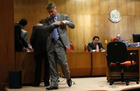 Brazilian tycoon Eike Batista walks as he leaves his court hearing in Rio de Janeiro
