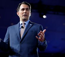 Walker signs measures critics call a Republican power grab