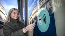 British high street installs 'smart window poster' which allows contactless donations to be made to homeless