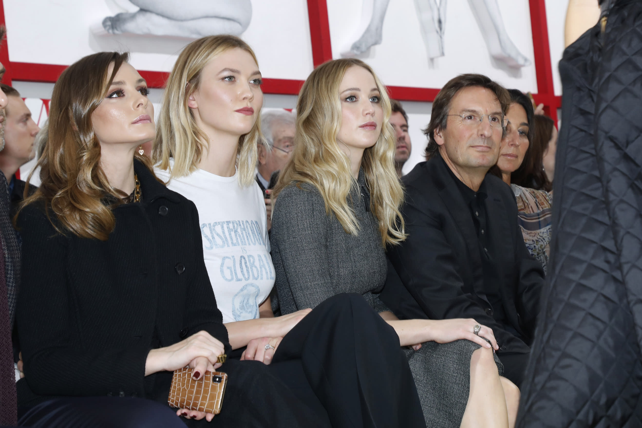 PARIS, FRANCE - FEBRUARY 26: (L-R) Olivia Palermo, Karlie Kloss, Jennifer Lawrence and CEO of Dior Pietro Beccari attend the Christian Dior show as part of the Paris Fashion Week Womenswear Fall/Winter 2019/2020 on February 26, 2019 in Paris, France. (Photo by Bertrand Rindoff Petroff/Getty Images)