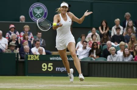 Maria Sharapova of Russia hits a return to Alison Riske of the U.S. during their women's singles tennis match at the Wimbledon Tennis Championships, in London