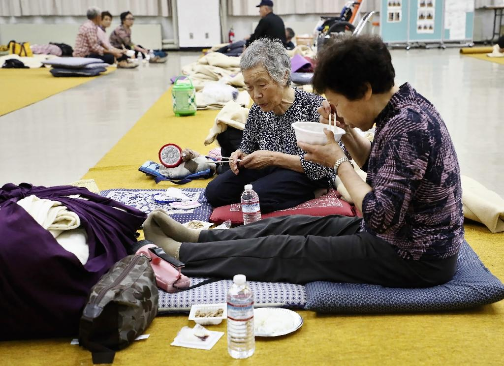Around 10,000 people spent the night in shelters (AFP Photo/JIJI PRESS)